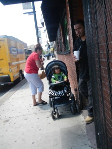 Family stands outside the a taqueriera